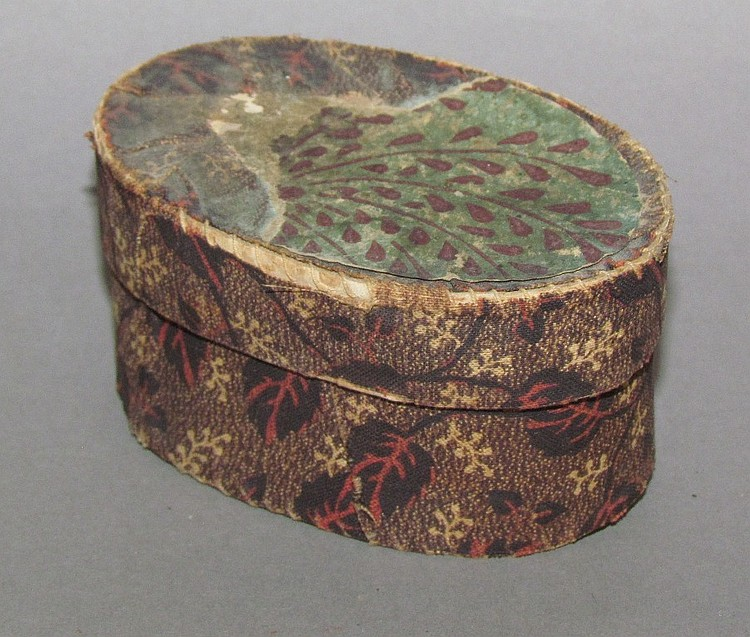Small oval cloth covered box with wallpaper on lid owned by Abraham Stoner (1858-1907)