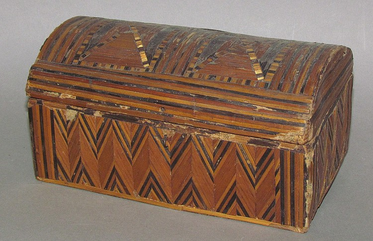 Domed wooden box covered with multicolored straw