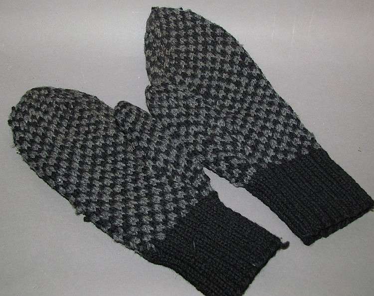 Pair of hand-knit woolen mittens