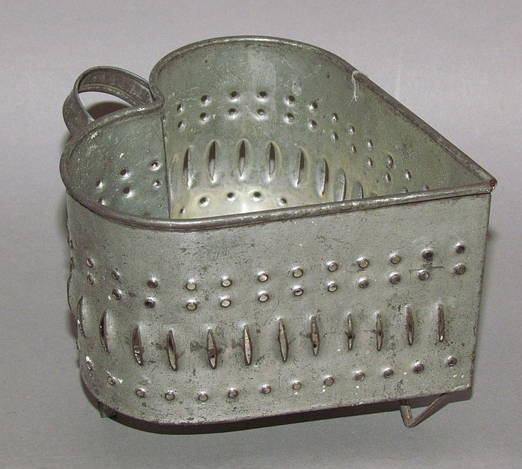 Pierced tin heart shaped cheese mold with handle