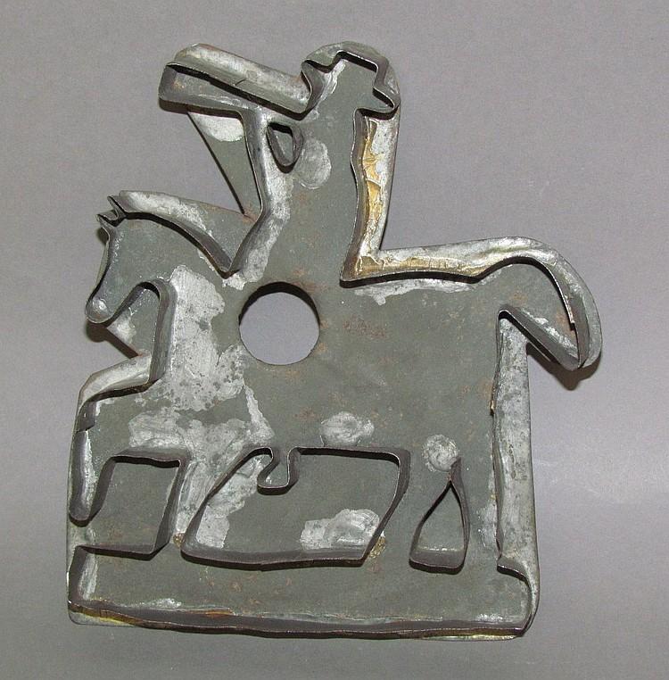 Tin cookie cutter, man on horseback w/ bugle
