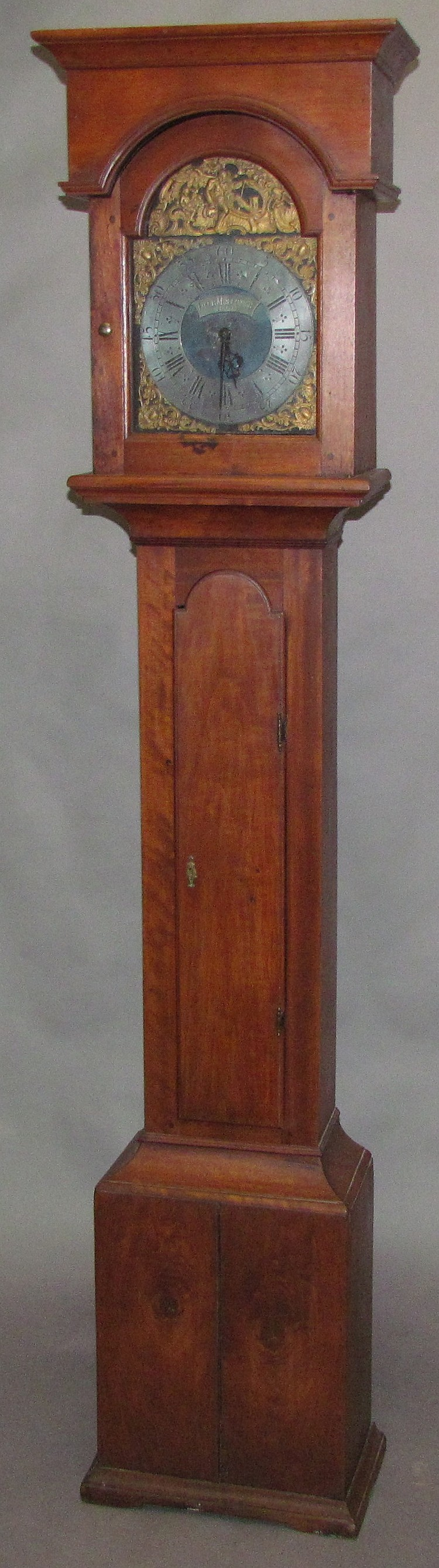 Lancaster County walnut flat top tall case clock with arched dial by Hans Jacob Moellinger