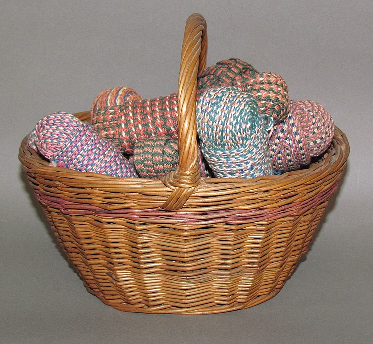Basket of hand-loomed tape