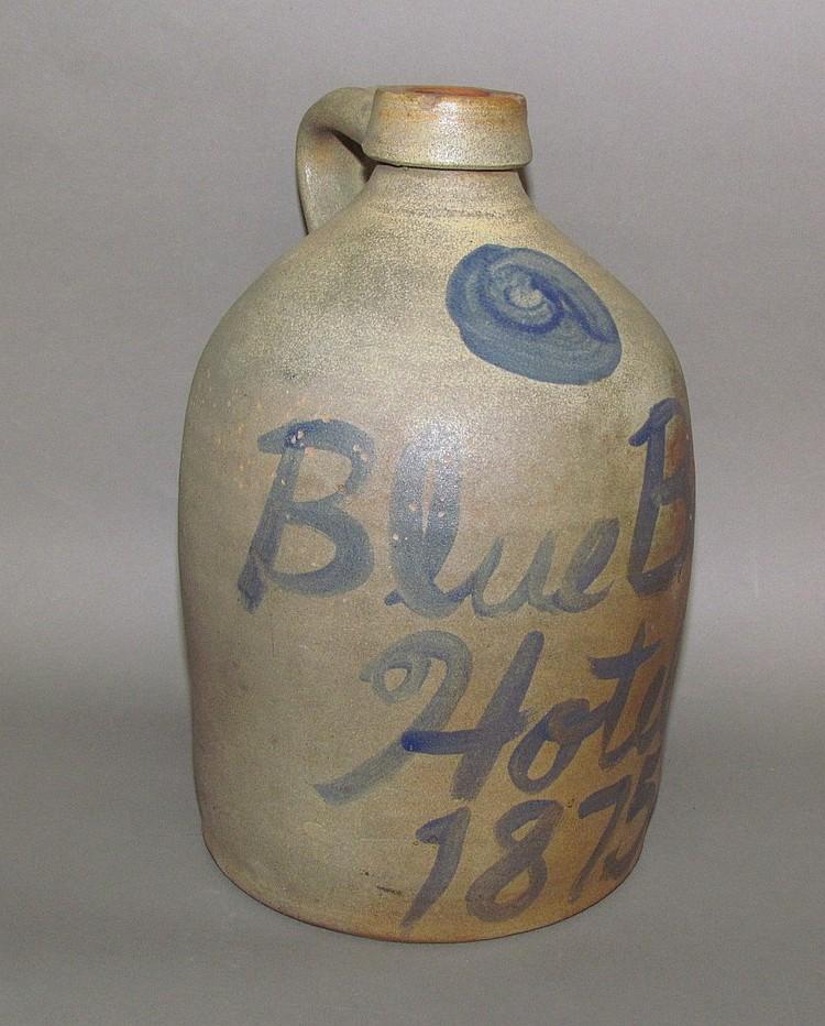 Stoneware advertising jug