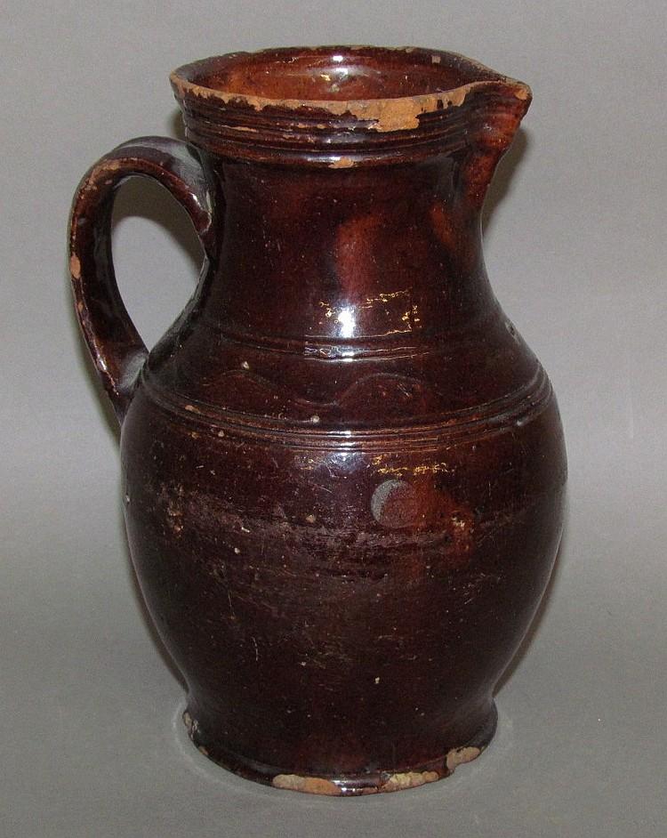 Redware milk pitcher