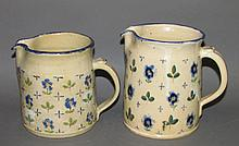 Pair of Russell Henry pitchers