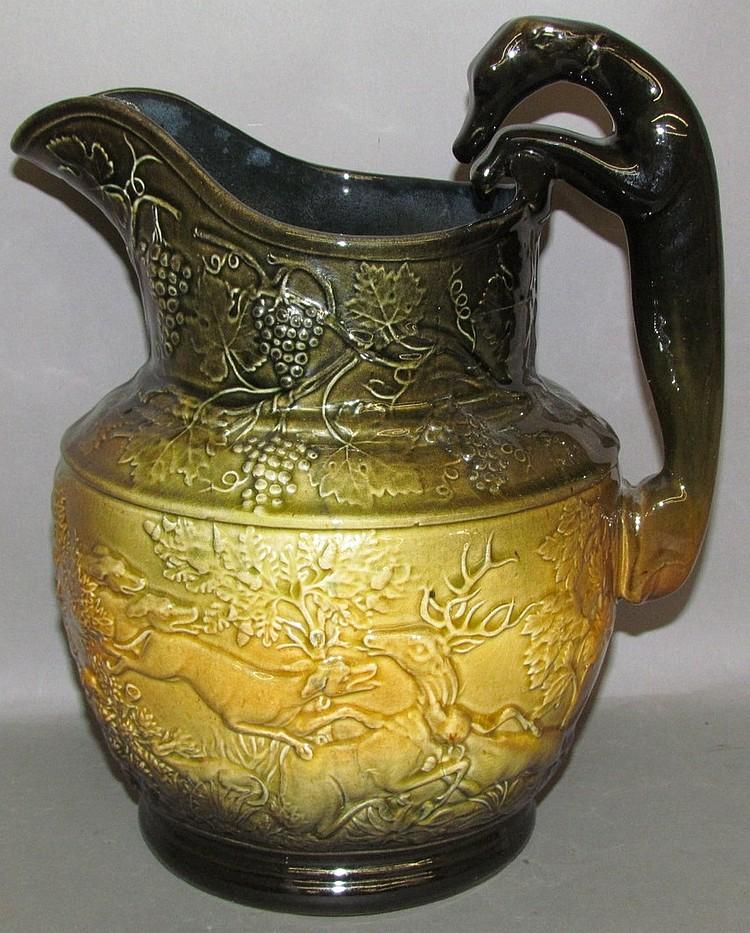 Lot 132: Yellow ware hound handled pitcher
