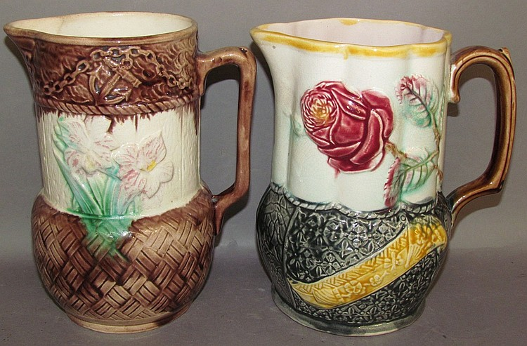 2 tall neck Majolica pitchers