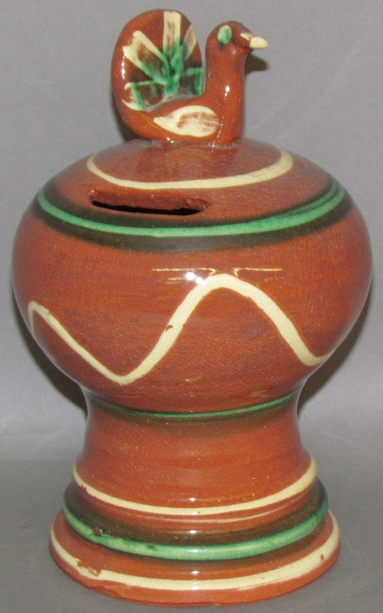 Dorothy Long redware slip decorated bank