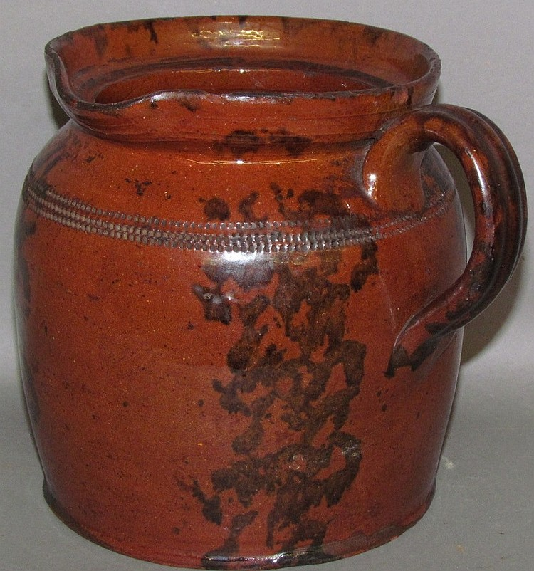 PA manganese decorated redware pouring pot