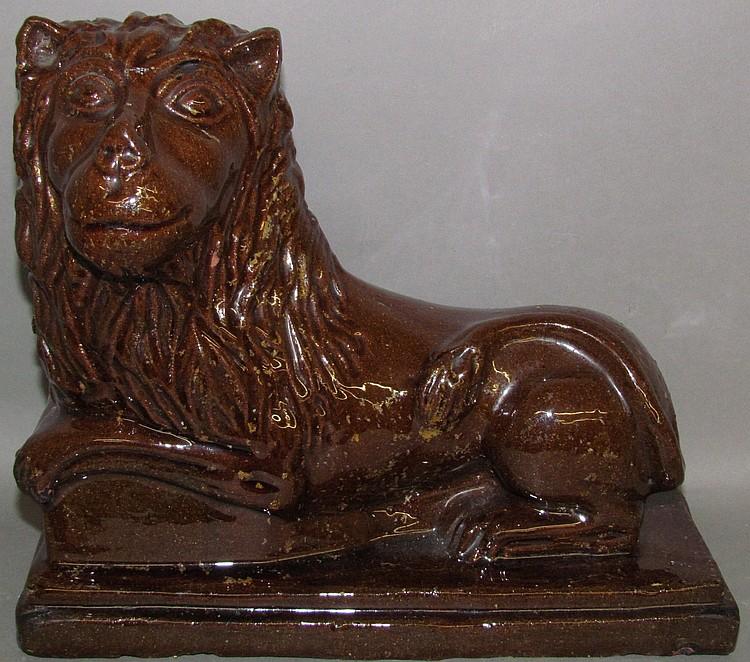 Molded redware lion doorstop