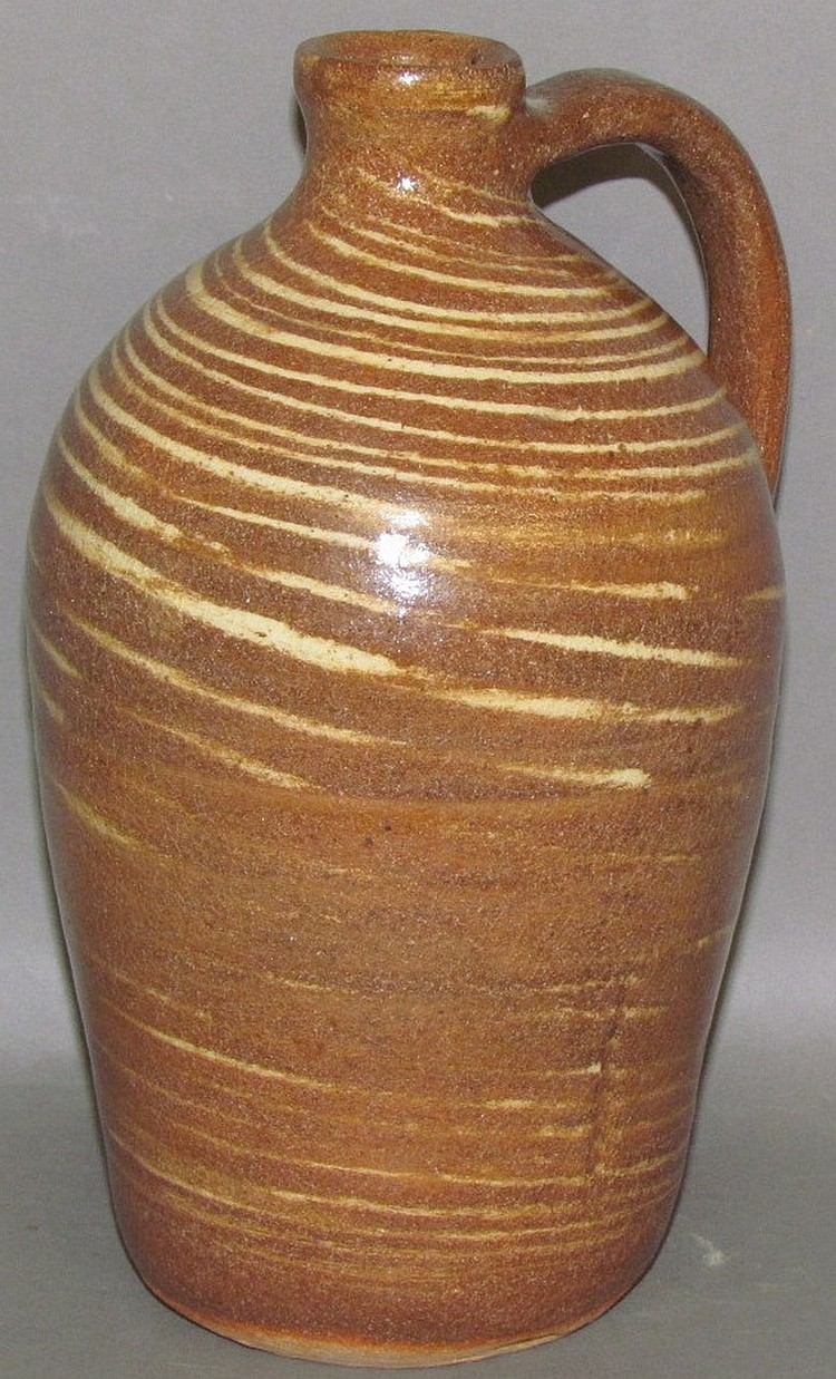 Small handled Cleater & Billie Meaders redware jug