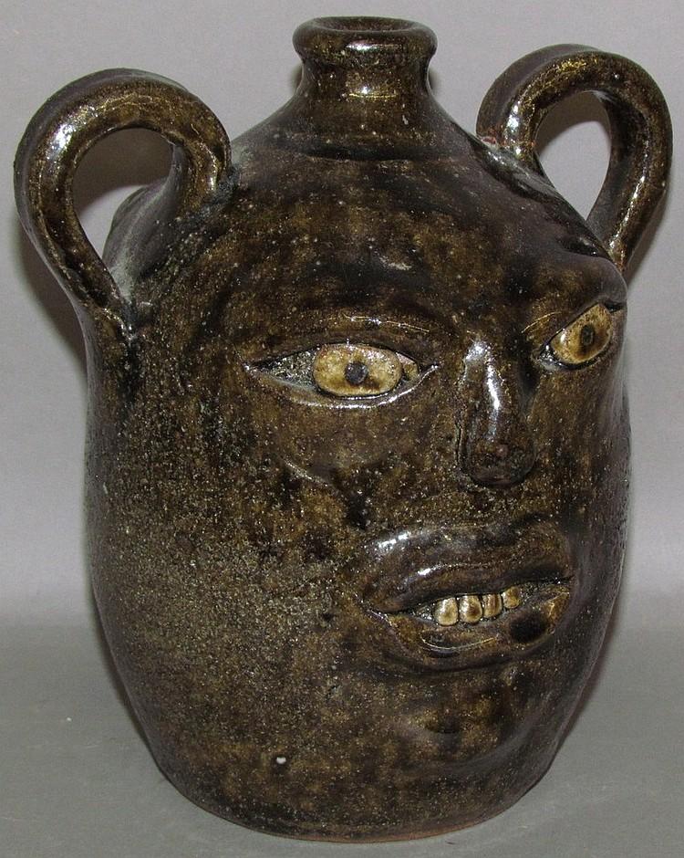 Lot 50: Anita Meaders redware two face jug