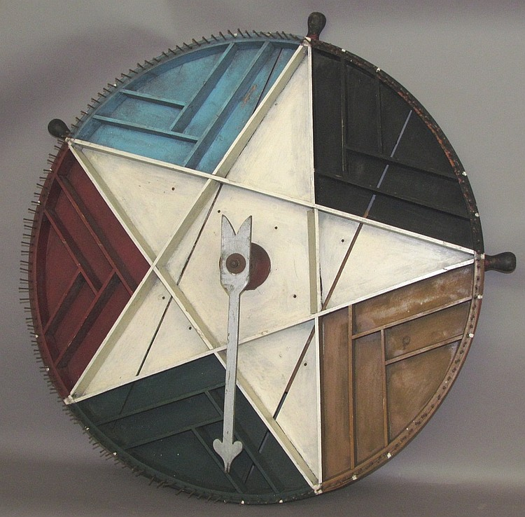 Lot 111: Early patriotic decorated game wheel