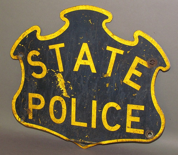 Small shield shaped metal State Police sign