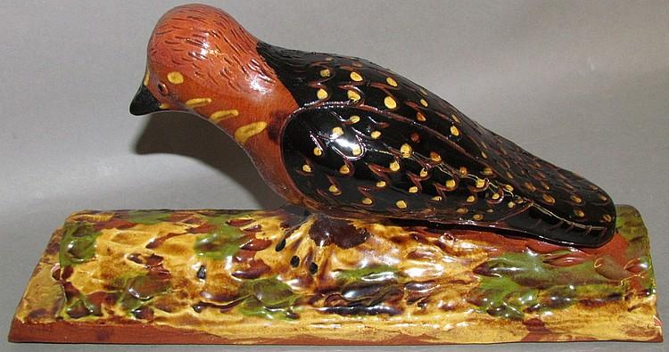 Lot 7: Breininger redware woodpecker