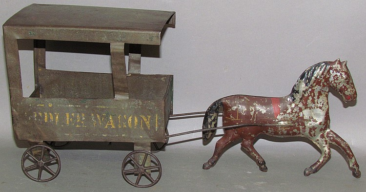 "Lot 36: German lithograph pressed tin ""peddler wagon"" toy"