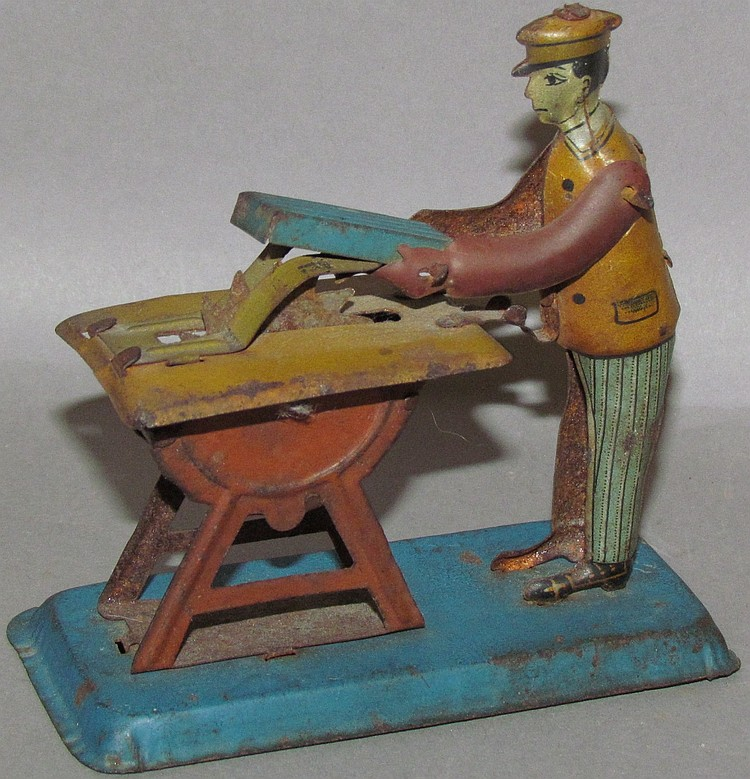 "German tin penny toy ""man at table saw"""