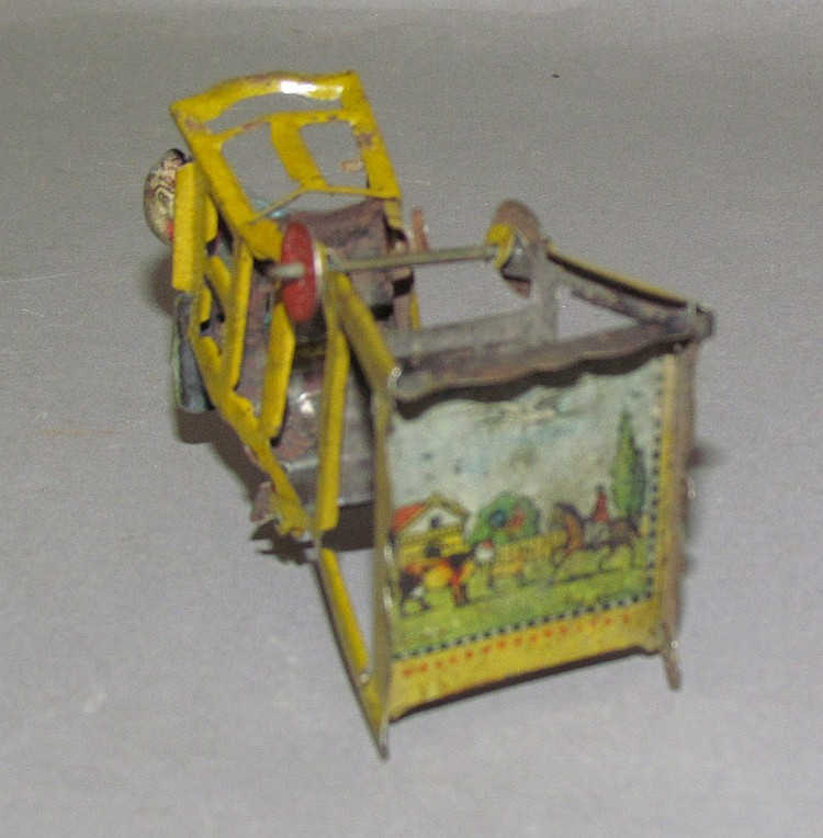 "Lot 34: German tin penny toy ""child in highchair"""