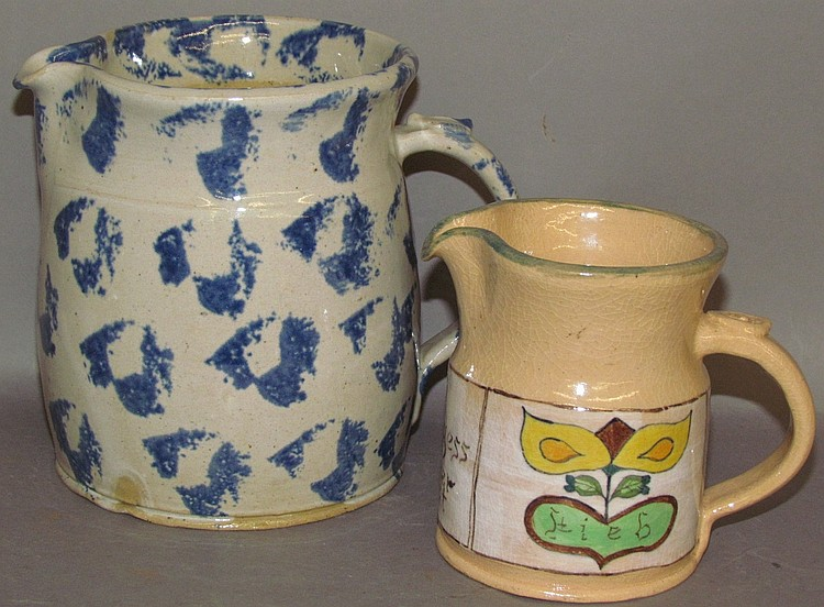 "2 ""Left Handed"" Rusell Henry pottery pitchers"