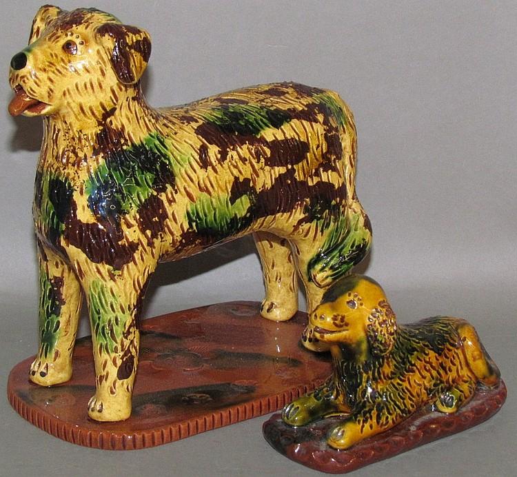 Lot 6: 2 Breininger sgraffito redware dogs