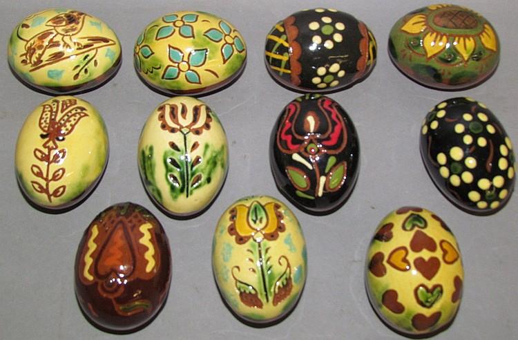 Lot 12: 11 Breininger redware Easter eggs