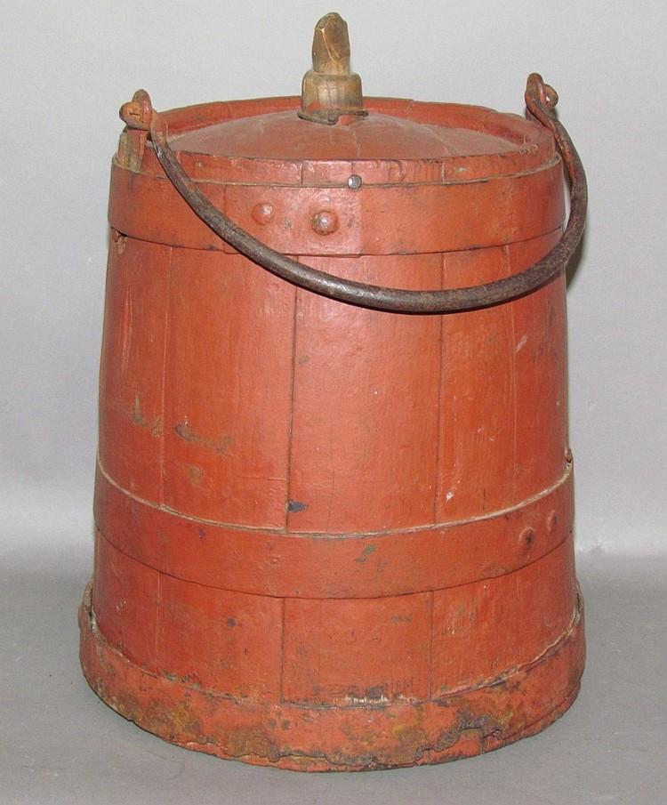 Red painted wooden kerosene bucket
