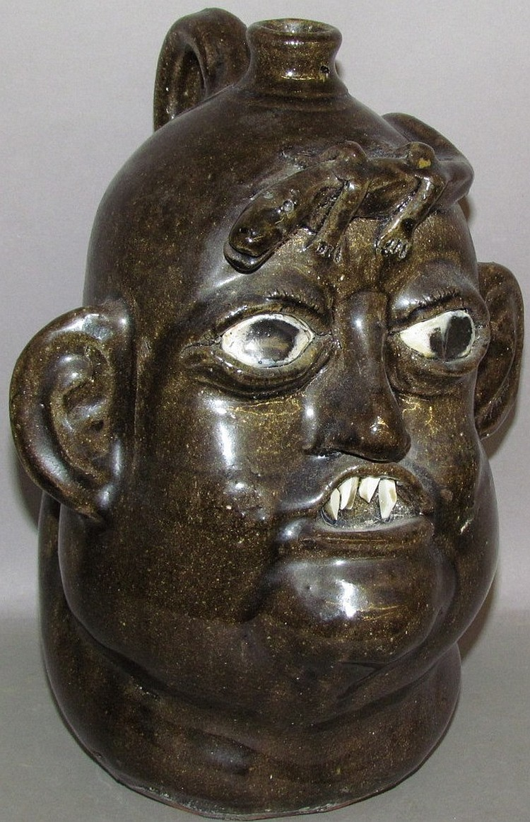 Matthew Hewell grotesque redware face jug