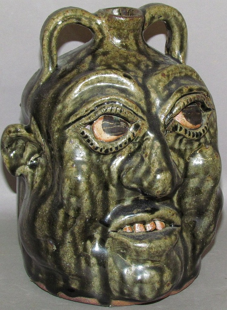 Lot 49: Cleater Meaders Jr. grotesque redware jug