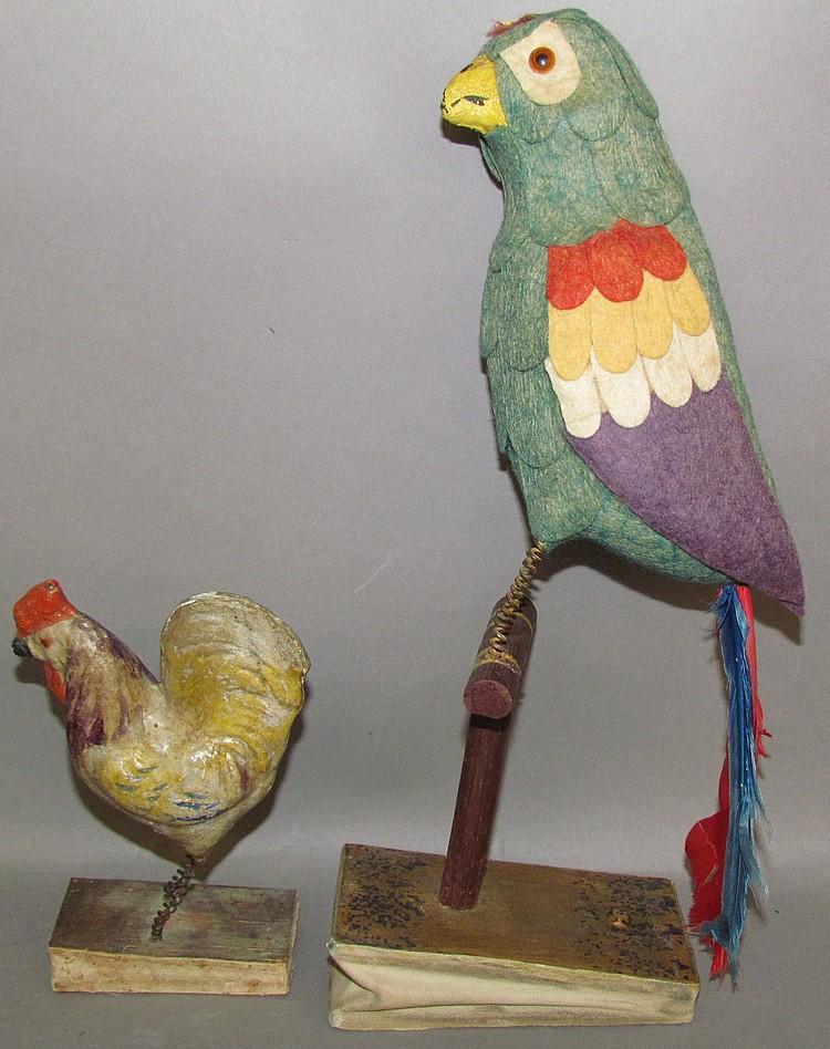 Lot 40: 2 bellow operated squeak toy birds