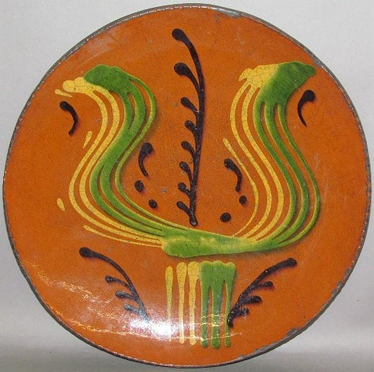 Lot 1: Greg Shooner tulip design slipware plate