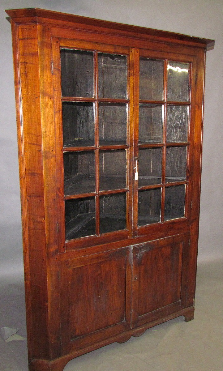One piece walnut corner cupboard