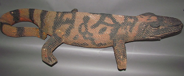 Folk art chip carved lizard sculpture