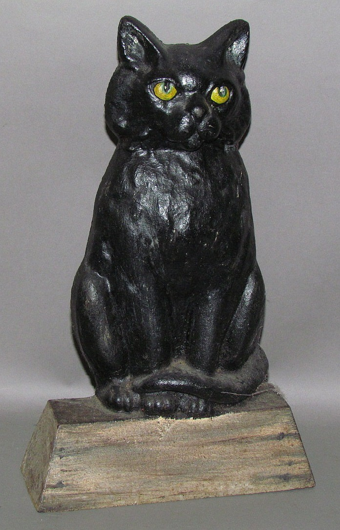 Seated cat cast iron door stop