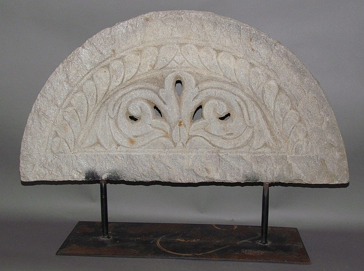 Ornamental carved stone pediment