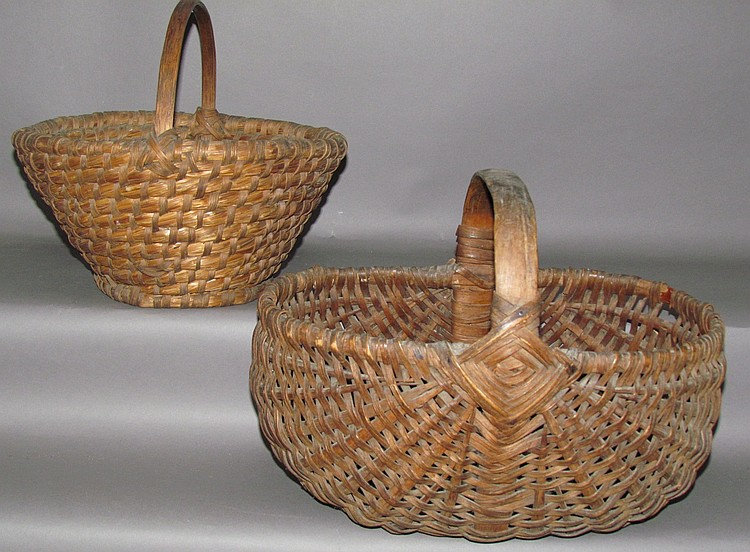 2 primitive handled baskets