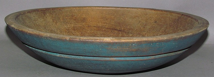 Blue painted wooden kitchen bowl