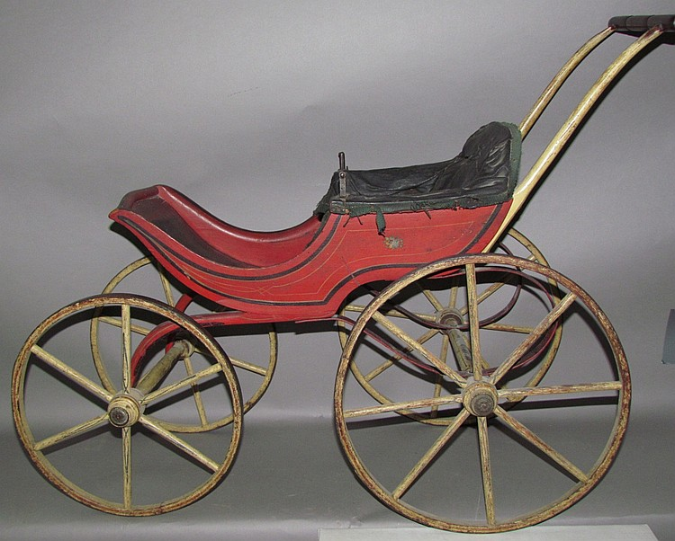 Early red painted doll stroller