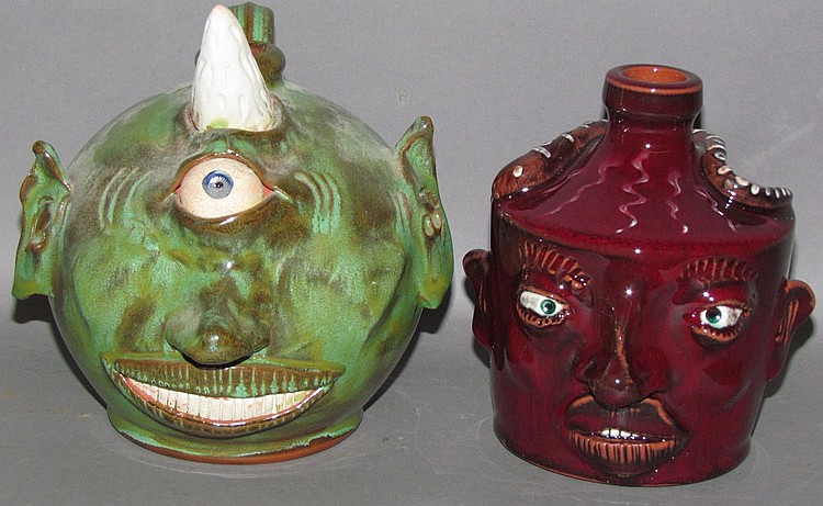 2 Nolde Forest Pottery comical redware jugs