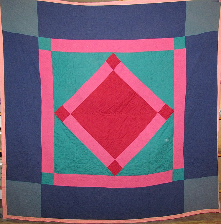 Red center diamond pattern Amish quilt