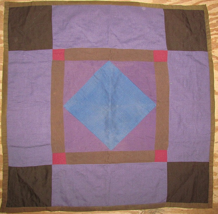 Blue center Amish crib quilt