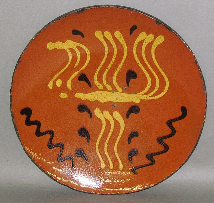 Shooner slip decorated redware plate
