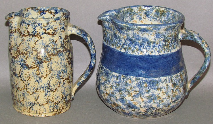2 Left Handed Russell Henry earthenware pitchers