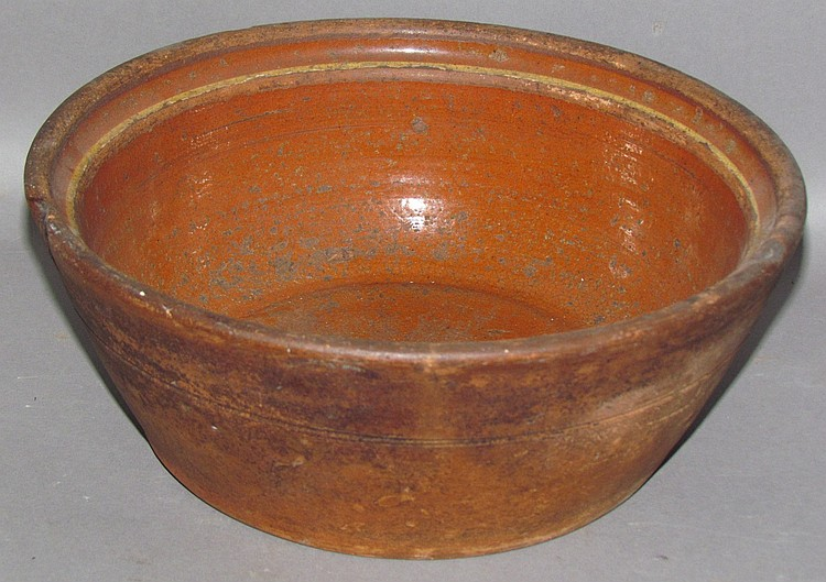 Redware bowl with yellow slip ring