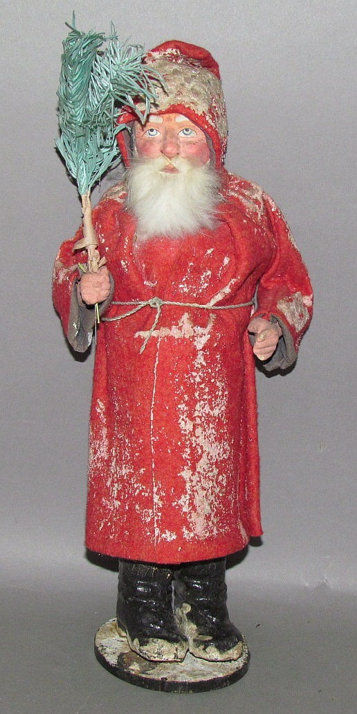 Early German Santa figure holding feather tree