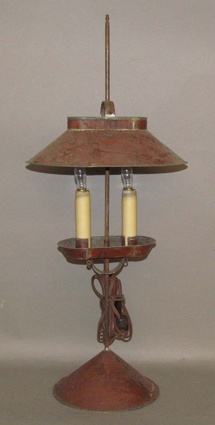 Lot 294: Tin hooded two socket candle lamp