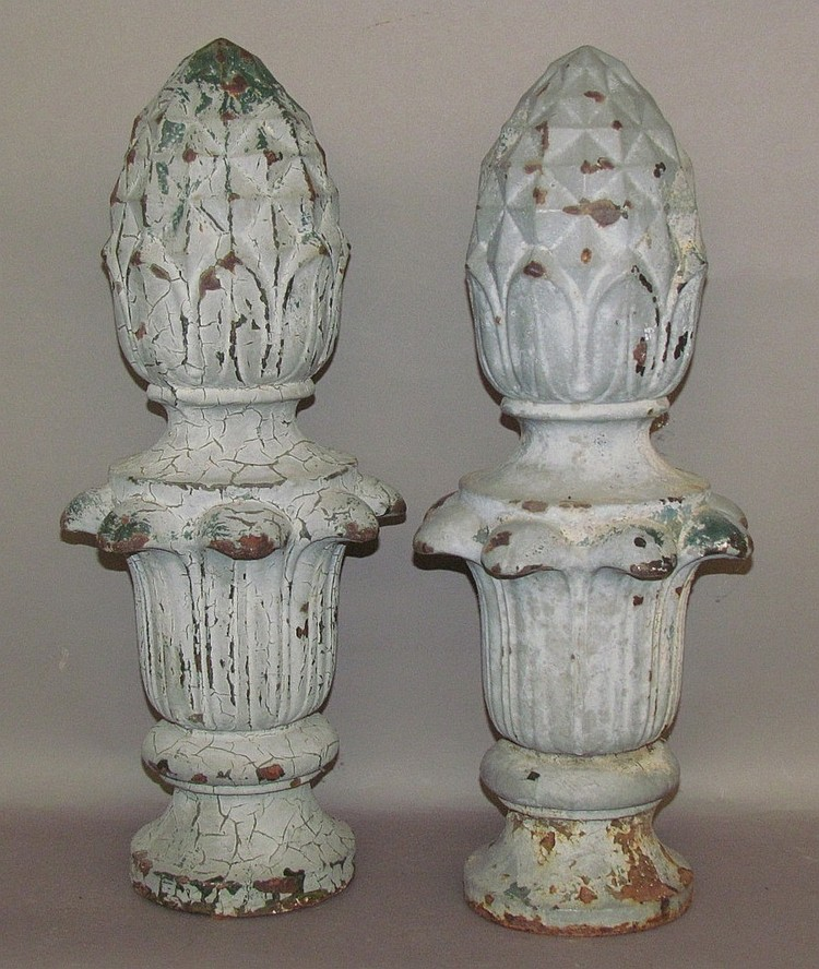 Lot 293: Pair of cast iron pineapple shaped post tops