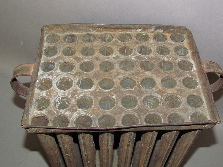 Lot 275: 48 hole tin candle mold