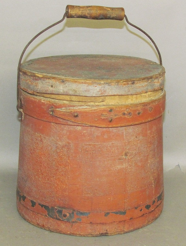 Lot 449: Red painted wooden firkin with wire swing handle