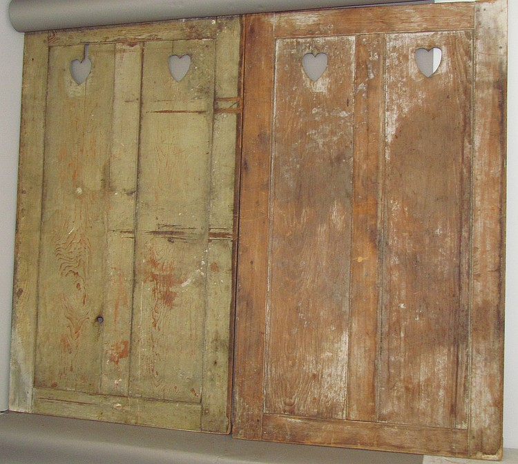 Pair of cupboard doors with heart cut outs